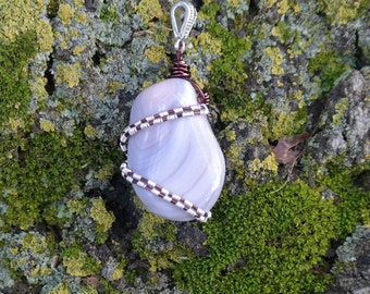 Wire wrapped botswana agate.