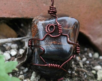 Wire wrapped tiger iron/mixed red tiger's eye pendant.