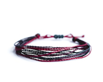Multi strap cords, waxed, tinted red, polyester Beach rope.