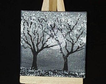3x3 black and white painting of trees at full moon