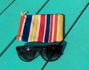 Small lined striped drawstring sunglasses case