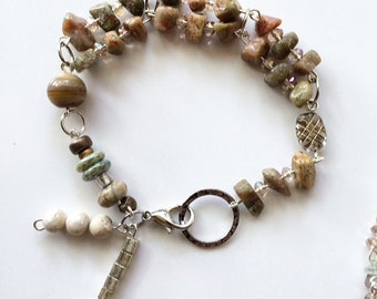 Raw stone bracelet. Multicolored stone with glass beads and metal.