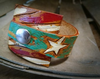 leather cuff, overlapping stars and stripes