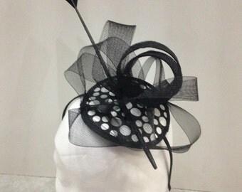 Black and white polka dot fascinator on a hairband