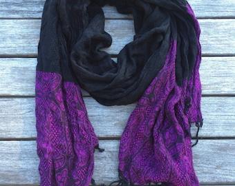 Black pashmina scarf with magenta design on the ends and black fringes