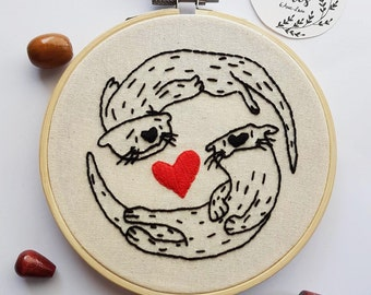 Loving otters on embroidery hoop embroidery