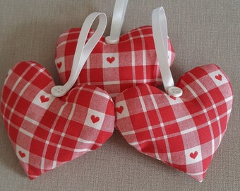 Hanging heart decoration in red and white check fabric