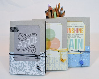 Blank journal with wrapped twine and glass bead closure
