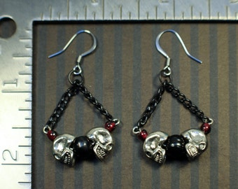 Pewter and garnet skull chain earrings