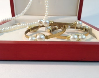Gold-finished textured brass bracelet with faux pearls Gemstone