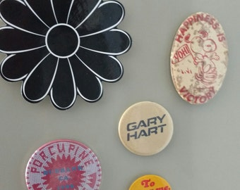 Fun set of magnets made from vintage coasters and pins.