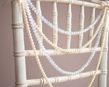 Diamond and pearl wedding chair garlands