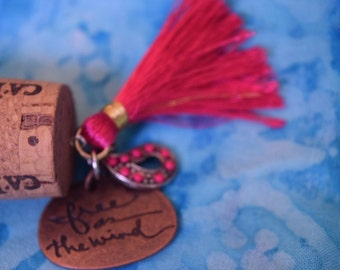 wine cork repurposed into a beautiful charm necklace