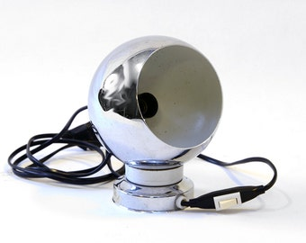Vintage 1970s chrome lamp, space age. Eyeball lamp