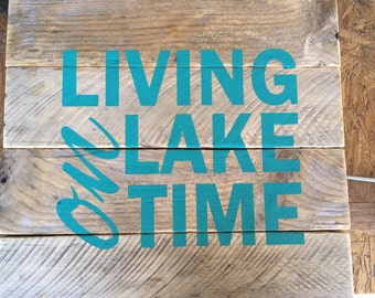 "Rustic handmade ""Living on the Lake"" sign."