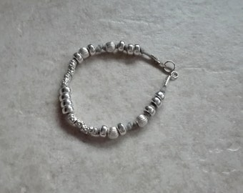 Fully bracelet in sterling silver with washers, grooved balls and nuggets