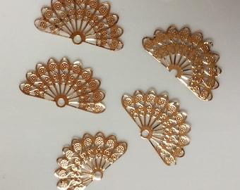 Golden fan connector beads, a set of five