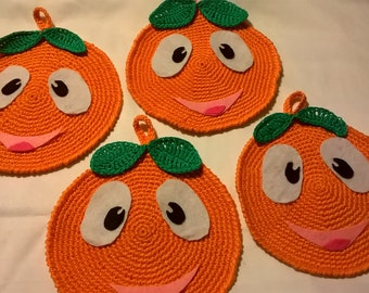 Orange handmade crochet pot holders pair