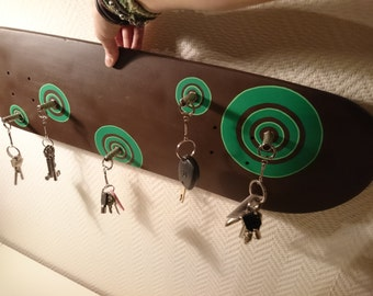 Wall key hooks made from an old skateboard and jacks