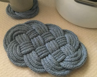 Hand knitted and knotted light blue trivet-nautical theme
