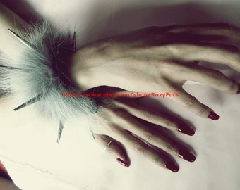 spiked wrist cuffs trimmed with fur