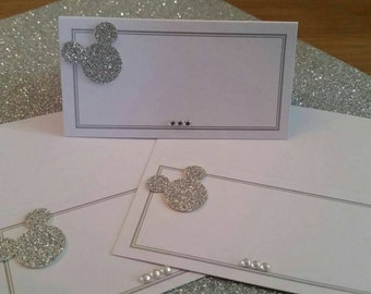 50 White and silver Mickey Mouse inspired place cards for wedding, birthday or dinner parties. Low cost, beautifully finished with care.