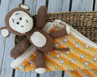 Flannel baby blanket with monkey stuffie