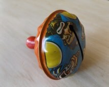 Vintage Metal Clown Noise Maker Toy Halloween Rattle/ U.S. Metal Toy Manufacturing Company Metal Clown Toy Red Wood Handle