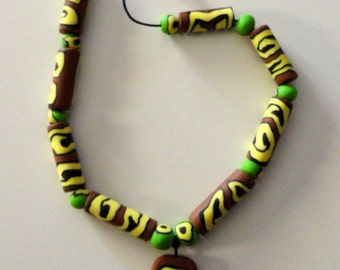 fimo necklace with pendant brown-yellow