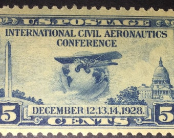 1928 5c Globe and Airplane Stamp