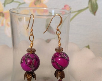 Purple floral bead with Swarovski crystal and brass leaf finding