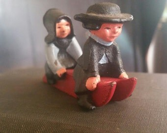 Vintage Amish Cast Iron Miniature Boy and Girl with Sled