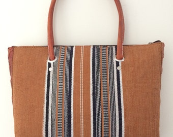 Orange handmade summer woven straw and leather purse from Madagascar