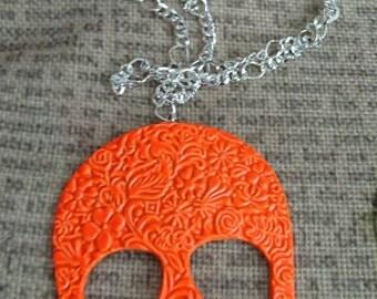 Bright orange skull necklace