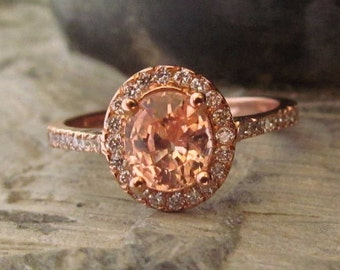 Peach champagne sapphire halo ring.
