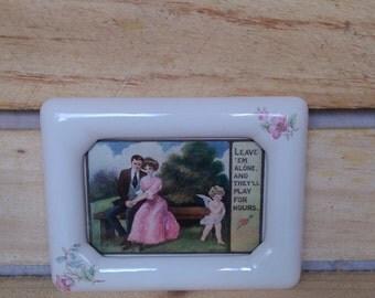 Vintage romance postcard in vintage ceramic frame