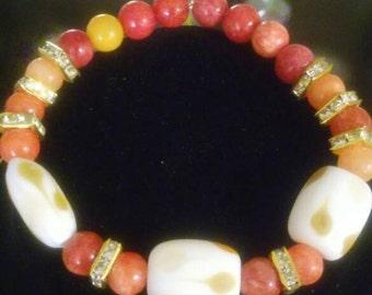 Burnt orange and cream polymar bracelet