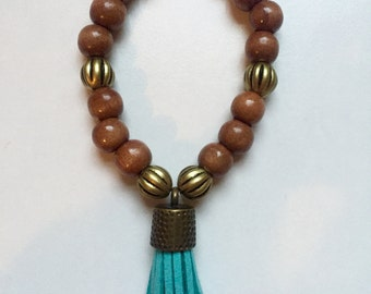 Dark brown wooden beaded bracelet with tassel