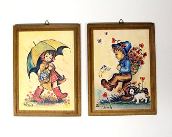 Retro prints of n. Clark & t. Jones on wood panel