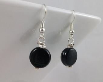 Black disk bead hook earrings.