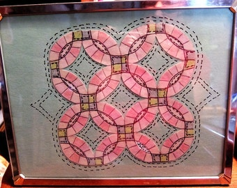 Double Wedding Ring quilt picture in frame.