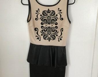 Leather and beaded Peplum dress