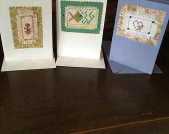 Three hand stitched cards