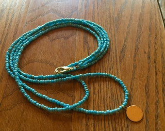 Double Stranded Turquoise Necklace with Gold Pendant