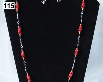 A Red, Orange and Black Coiled Wire Necklace and Matching Earring Set with Silver Coloured Chain,