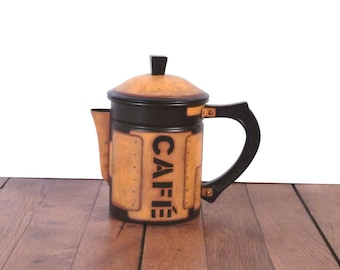 French coffee pot,  decorative former object,  industrial style , aluminium coffee pot, black background and rusty metal imitation.