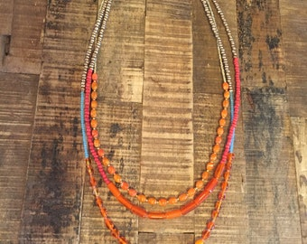 Bright red and orange beaded necklace