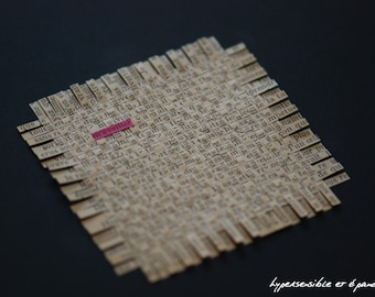 """Collage of lines of text woven paper - crossword - """"Wake me up"""""""