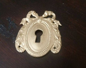 Antique French brass keyhole