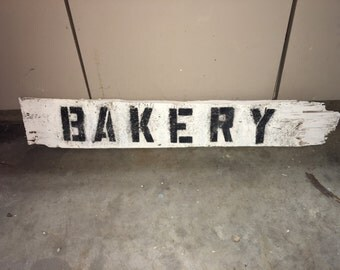 """Farmhouse Barnwood """"Bakery"""" hanging sign."""
